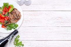 Grilled rib with grilled vegetables. Background. Stock Images