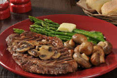 Grilled rib steak with asparagus Stock Photo
