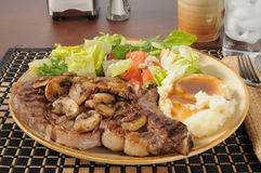 Steak with salad and mashed potatoes Royalty Free Stock Photo