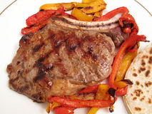 Grilled Rib Steak and Peppers Dinner Royalty Free Stock Images