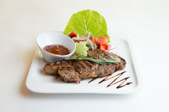 Grilled ribeye beef steak, herbs and spices. royalty free stock image