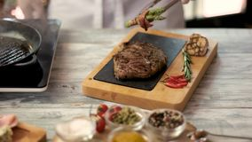 Grilled ribeye steak on board. stock footage