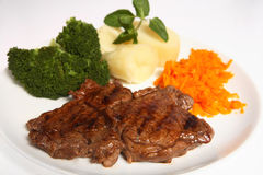 Grilled ribeye steak carrots broccoli potato Royalty Free Stock Photography