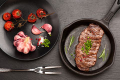 Grilled Ribeye steak entrecote on pan Stock Photos