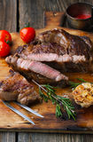 Grilled ribeye steak marbled meat with salt, rosemary and garlic Royalty Free Stock Image