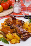 Grilled ribs with baked potato Royalty Free Stock Photo