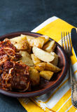 Grilled ribs with barbecue sauce, onion and hot crispy potatoes Stock Photography