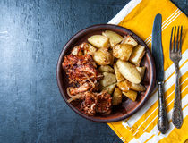 Grilled ribs with barbecue sauce, onion and hot crispy potatoes Stock Photos