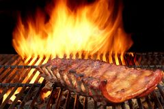 Grilled Ribs And Flaming Hot Grill On The Background. Royalty Free Stock Photos
