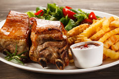 Grilled ribs and French fries Stock Image