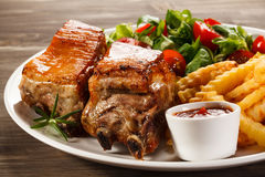 Grilled ribs and French fries Stock Photo