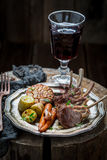 Grilled ribs of lamb served with red wine Stock Photography