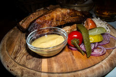 Grilled ribs and pickles platter in Czech pub Stock Photography