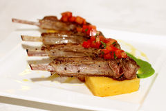 Grilled ribs with polenta royalty free stock photography