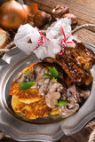 Grilled ribs with potato pancakes Stock Photo