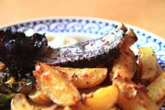 Grilled ribs and potatoes Stock Image