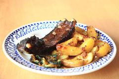 Grilled ribs and potatoes Royalty Free Stock Photos