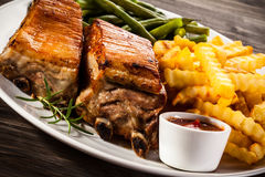 Grilled ribs, potatoes and green bean Royalty Free Stock Images