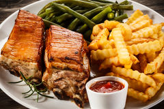 Grilled ribs, potatoes and green bean Stock Photography