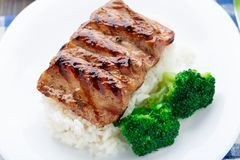 Grilled ribs with rice and broccoli Stock Photos