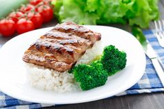 Grilled ribs with rice and broccoli Royalty Free Stock Photo