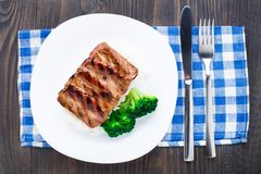 Grilled ribs with rice and broccoli Stock Photography