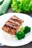 Grilled ribs with rice and broccoli Stock Photo