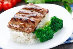 Grilled ribs with rice and broccoli Stock Images