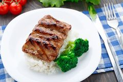 Grilled ribs with rice and broccoli Royalty Free Stock Photography