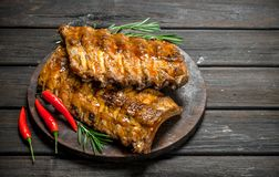 Grilled ribs with rosemary and hot chili peppers stock photography