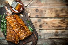 Grilled ribs with rosemary, spices and sauce stock images