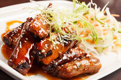 Grilled ribs with salad Royalty Free Stock Image