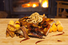 Grilled ribs topped with barbecue sauce and onion rings Royalty Free Stock Photography