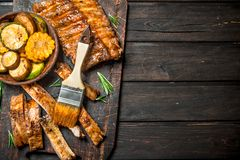 Grilled ribs and vegetables stock image