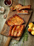 Grilled ribs on wooden cutting board Royalty Free Stock Photo