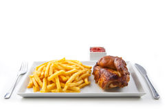 Grilled roasted half chicken with chips Stock Images