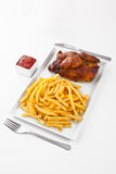 Grilled roasted half chicken with chips Royalty Free Stock Images