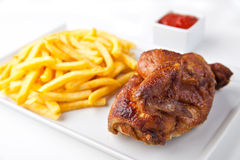 Grilled roasted half chicken with chips Stock Photos