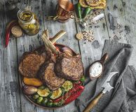 Grilled roasted lamb,mutton meat chops with vegetables on the plate . Rustic food concept.  stock images