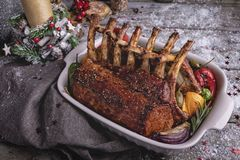 Grilled roasted rack of lamb with vegetables. New Year christmas composition,decoration. royalty free stock images