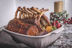 Grilled roasted rack of lamb with vegetables. New Year christmas composition,decoration. stock photos