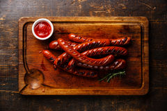 Grilled roasted sausages and ketchup sauce Stock Images