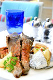 Grilled rock lobster. Platter on dining table Royalty Free Stock Images