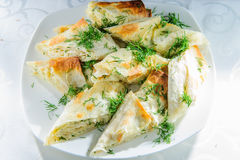 Grilled rolls of bread lavash with cheese inside. Royalty Free Stock Images