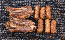 Grilled Romanian meat slices and rolls - mititei, mici Royalty Free Stock Image