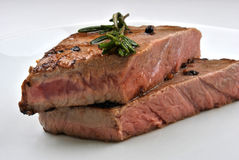 Grilled rump steak. With organic rosemary on a plate Stock Photos