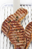 Grilled rump steak on aluminum grill pan Royalty Free Stock Photo