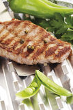 Grilled rump steak on aluminum grill pan Royalty Free Stock Images