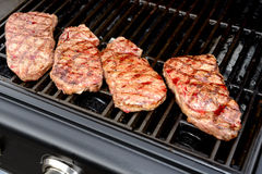 Grilled rump steak on barbecue Royalty Free Stock Image