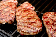 Grilled rump steak on barbecue Stock Image